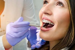 woman getting braces examined