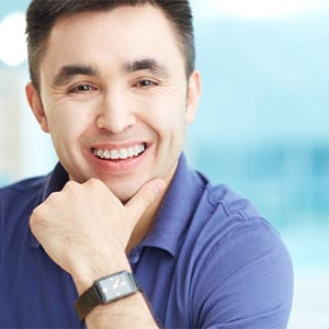 adult asian man with braces smiling